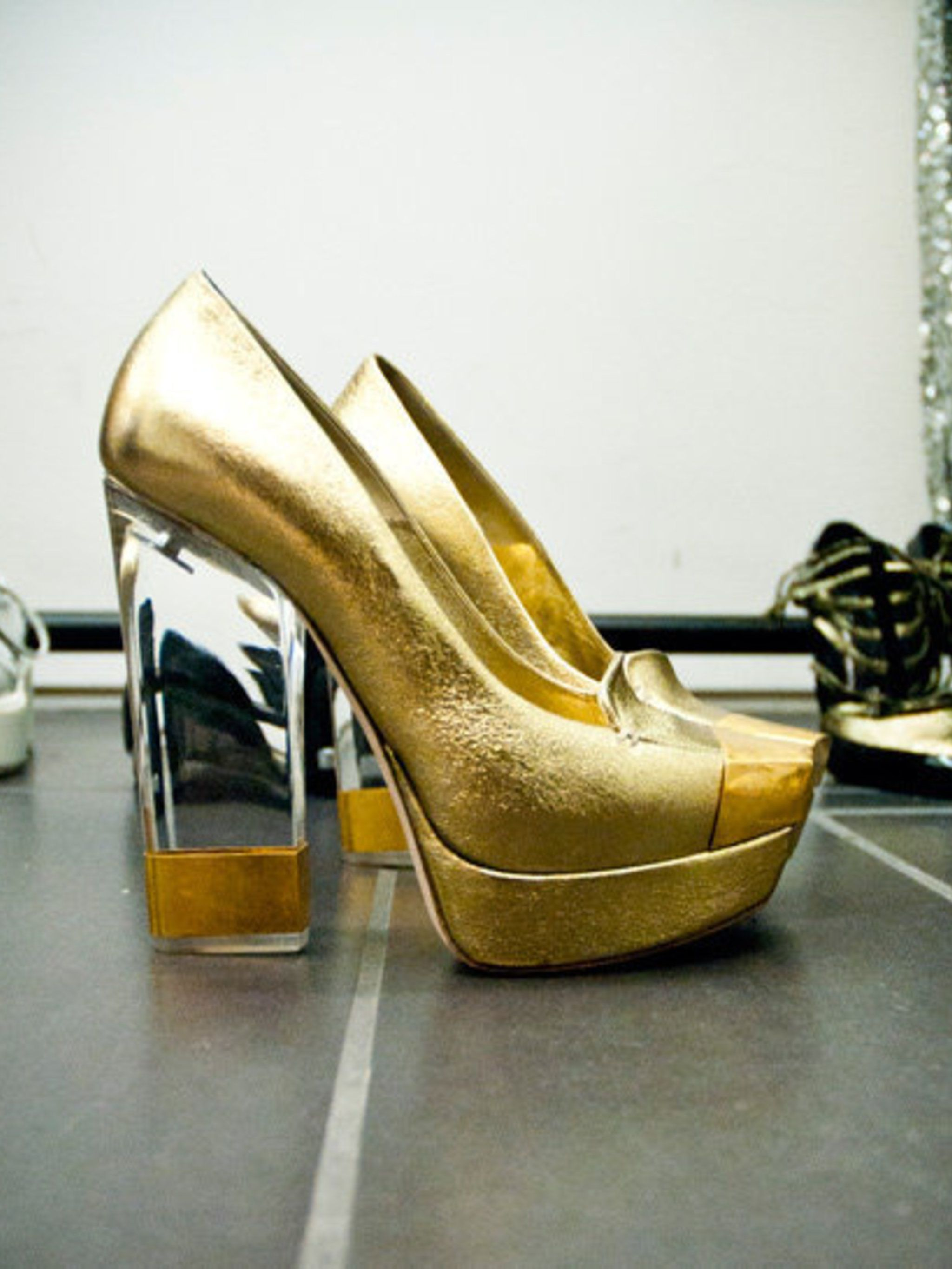 <p>Gold McQueen shoes called in for the Jessie J cover shoot.</p>