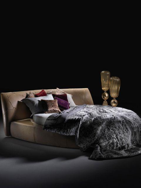 <p>Roberto Cavalli Home's round bed</p>