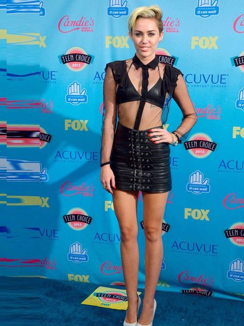 """<p><a href=""""http://www.elleuk.com/star-style/celebrity-style-files/miley-cyrus-best-outfits-pictures"""">Miley Cyrus</a> in <a href=""""http://www.elleuk.com/star-style/celebrity-fashion-trends/saint-laurent-ss13-aw13"""">Saint Laurent</a>.</p><p><em><a href=""""http"""