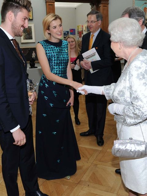 <p>Henry Holland and Agyness Deyn meet the Queen</p>