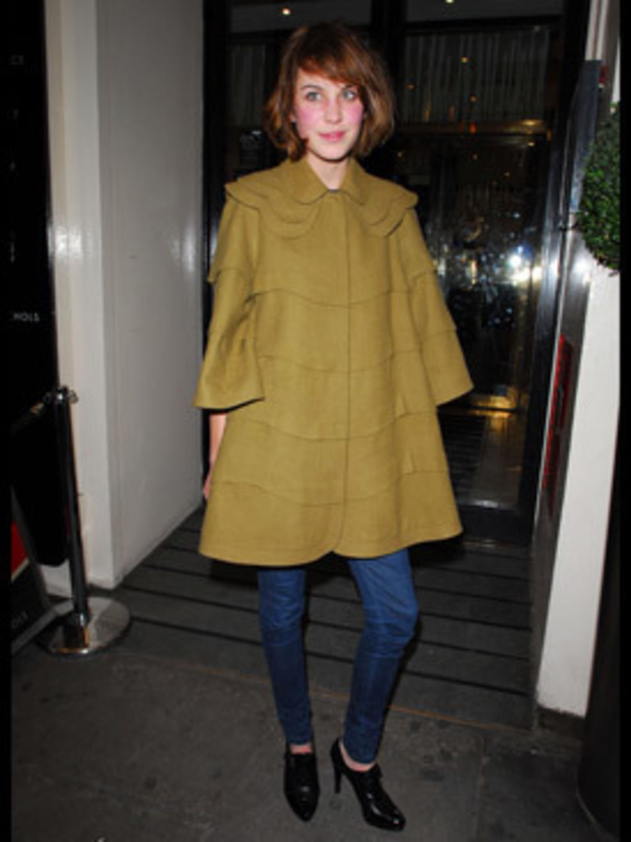<p>Alexa's our caped fashion crusader in her mustard cloak, expertly teamed with super skinny jeans and high heels.</p>