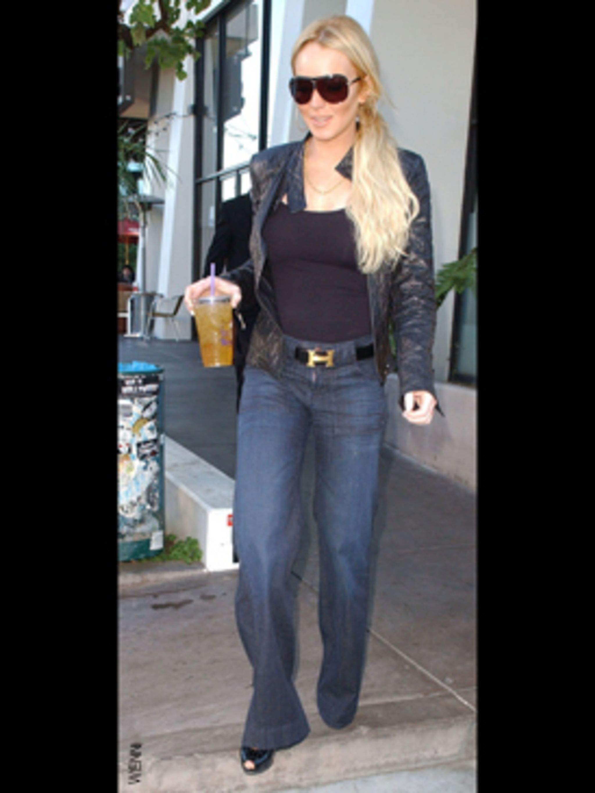 <p>Sporting this seaon and next's essential high waisted flared denim, expertly teamed with a leather biker, it looks like Lindsay's fashion credentials have recovered as well as she has!</p>