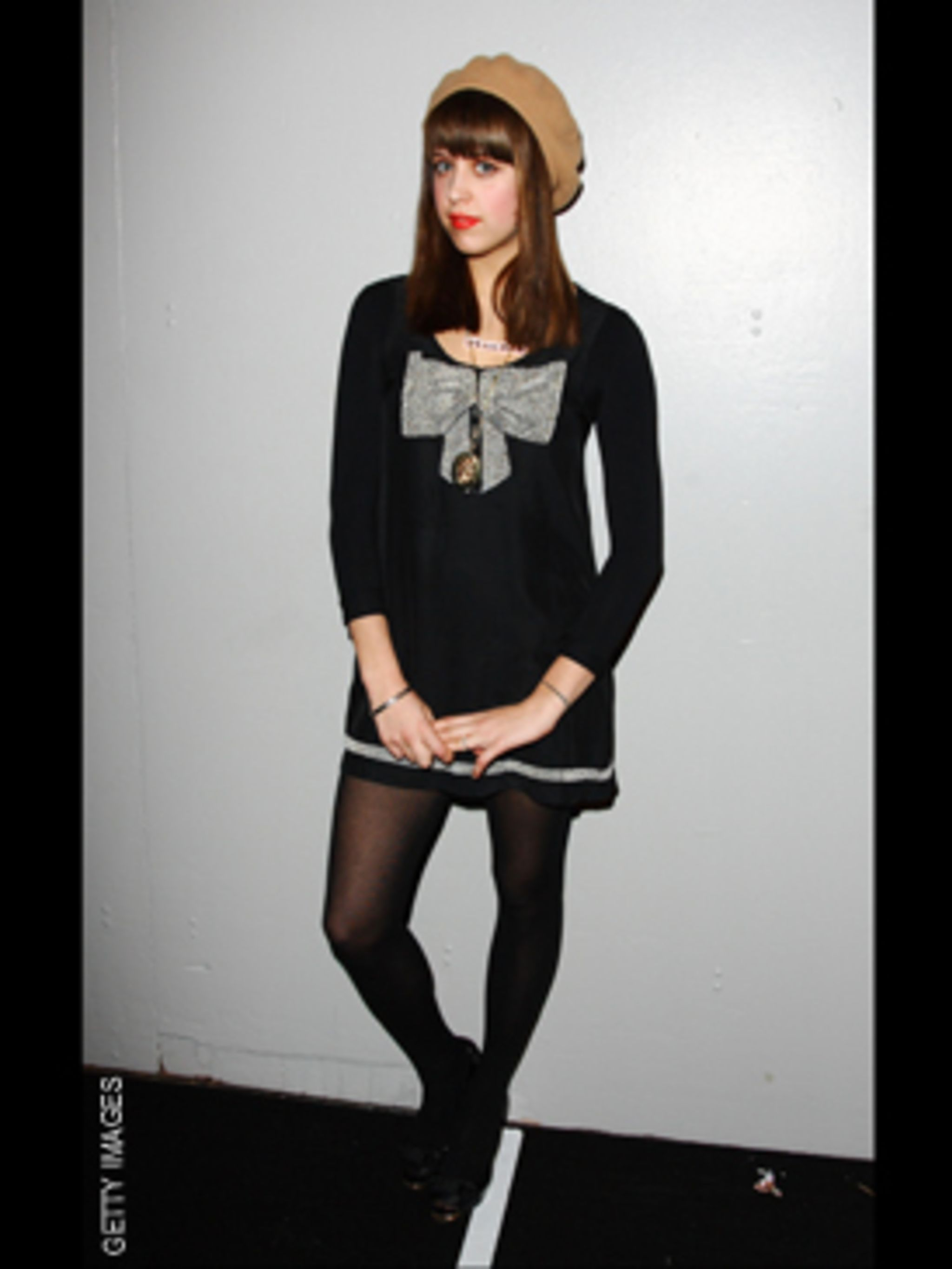 <p>We love the Parisian twist of Peache's sweater dress and beret.</p>