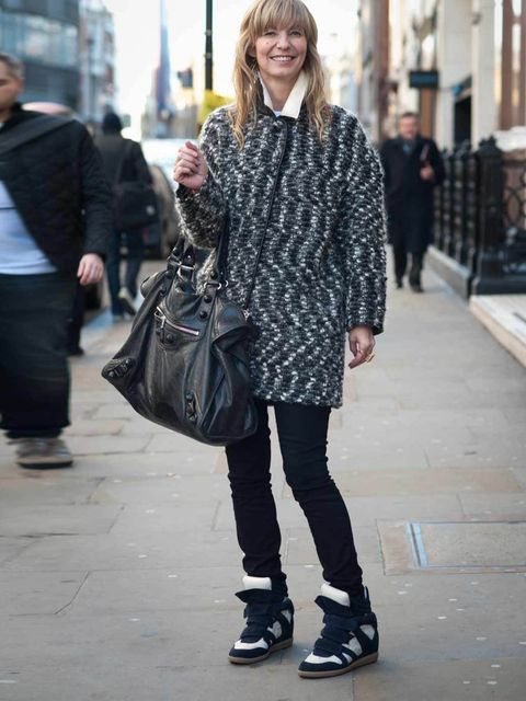 <p>Julie Lingard, 39, Shopowner. Isabel Marant coat and trainers, J Brand jeans, Balenciaga bag, Mawi ring.</p>