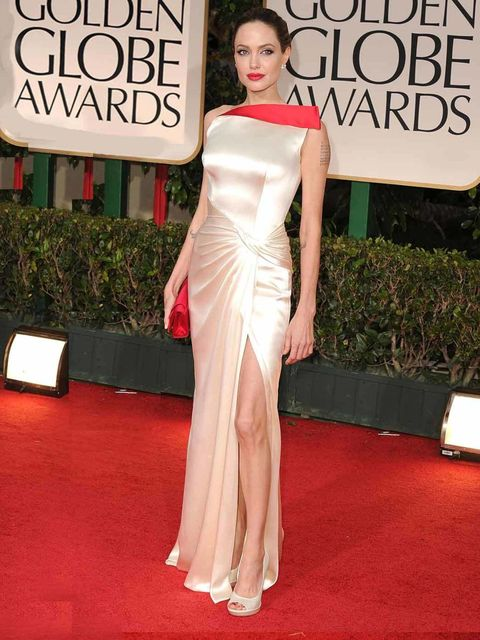 """<p><a href=""""http://www.elleuk.com/star-style/celebrity-style-files/angelina-jolie"""">Angelina Jolie</a> stunned in Atelier <a href=""""http://www.elleuk.com/catwalk/designer-a-z/versace/spring-summer-2011"""">Versace</a> at the Golden Globes, 15 January 2012</p>"""