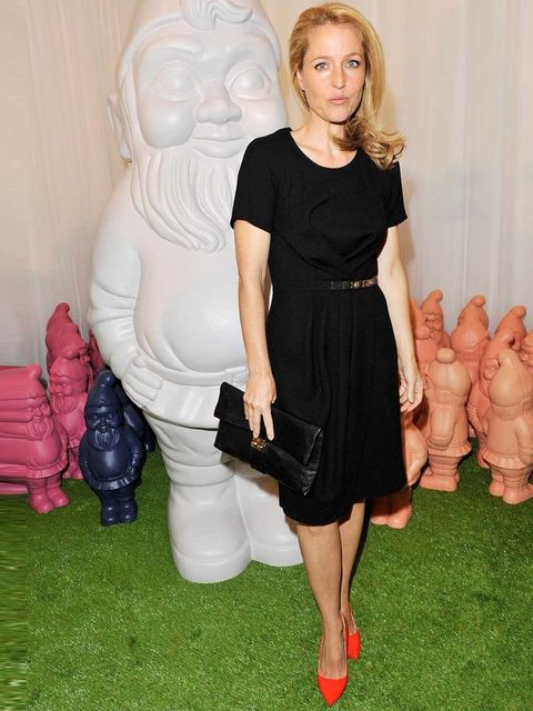 <p>Gillian Anderson wore a black dress to Mulberry's Spring Summer 13 show.</p>