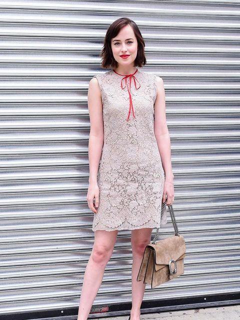 Dakota Johnson attends the Gucci Cruise 2015 show in New York, June 2015.