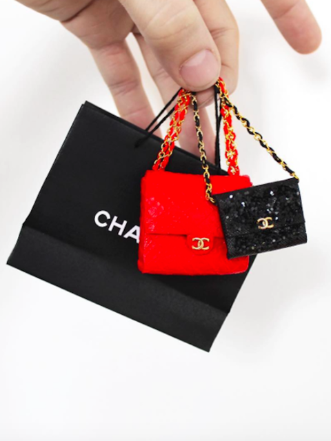 <p>Designer Phillip Nuveen makes miniature versions of sought after luxury goods, including everything from designer handbags to Eames chairs. As if we didn't already want a Chanel bag enough!</p>
