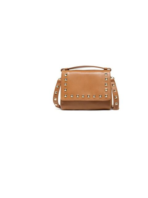 "<p><a href=""http://www.zara.com/webapp/wcs/stores/servlet/product/uk/en/zara-S2012-s/244410/878586/STUDDED%2BMINI%2BMESSENGER%2BBAG"">Zara</a> studded mini messenger bag, £69.99</p>"