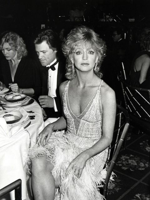 <p>She was doing statement red carpet gowns way before Riri and co - seen here at a 1985 gala</p>