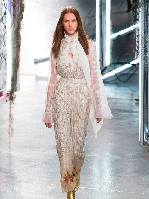 <p>RODARTE<br />These gold boots would add a touch of attitude to Rachel's ultra feminine style</p>
