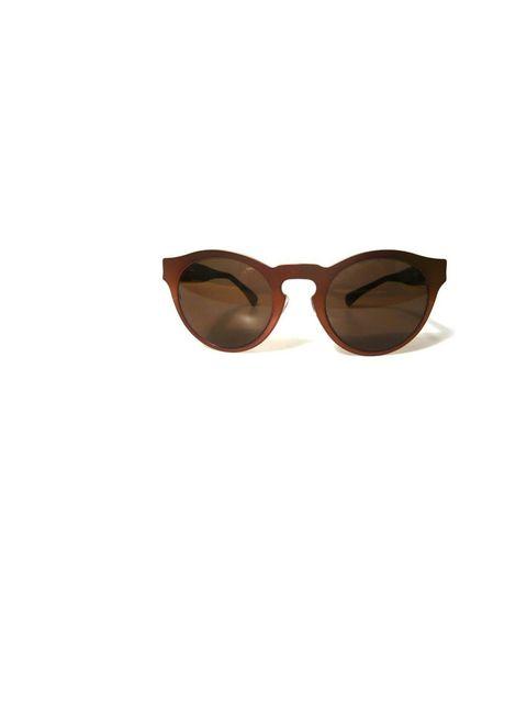 "<p>Illesteva 'Beca' bronze sunglasses, £140, at <a href=""http://www.triads.co.uk/triads-ladies-c3/accessories-c42/eyewear-c111/beca-bronze-sunglasses-p57050"">Triads</a></p>"