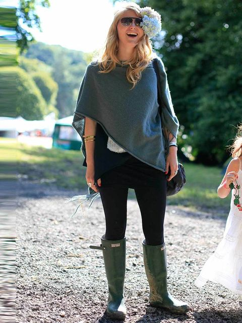 <p>Annabell Norbury, 25, Actress. Whistles poncho, top from Thailand, Hunter wellies, H&M bag, Alexander McQueen bangle.</p>