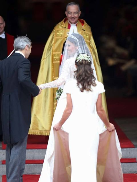 "<p><a href=""http://www.elleuk.com/starstyle/style-files/(section)/kate-middleton"">Catherine</a> preparing to walk into Westminster Abbey</p>"