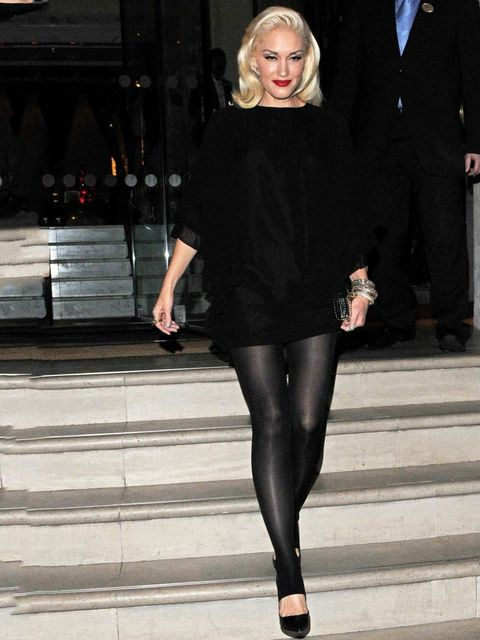 <p>Gwen Stefani teams her leather trousers with oversized knit, a lick of red lipstick and perfectly coiffed hair whilst out in London, September 2012.</p>