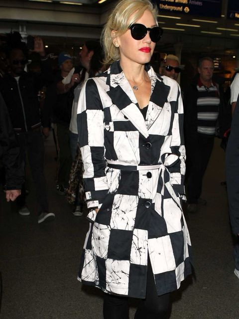 <p>Gwen Stefani taps into the black and white trend with checkerboard mac whilst out in London, September 2012. </p>