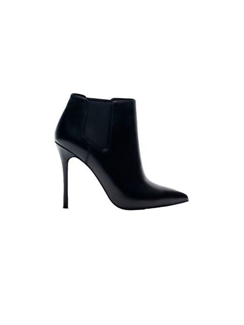 "<p>Black heeled boots, <a href=""http://www.uterque.com/gb/en/footwear/view-all/high-heel-ankle-boots-with-elastics-c77002p4383149.html?color=040"">Uterqüe</a> £125</p>"