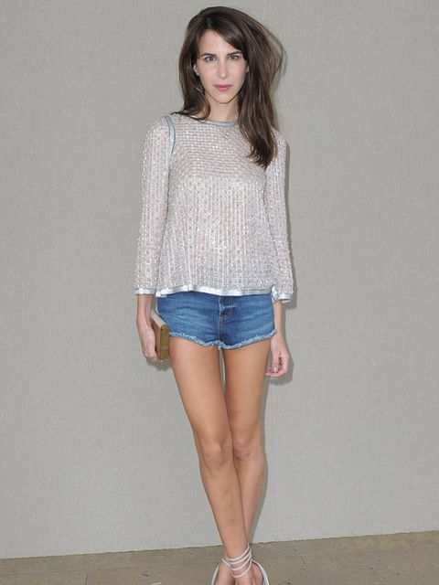 <p>Caroline Sieber is at the Miu Miu Spring/Summer 2012 show wearing jean shorts and a sliver weave jumper and pointed heels, October 2011.</p>