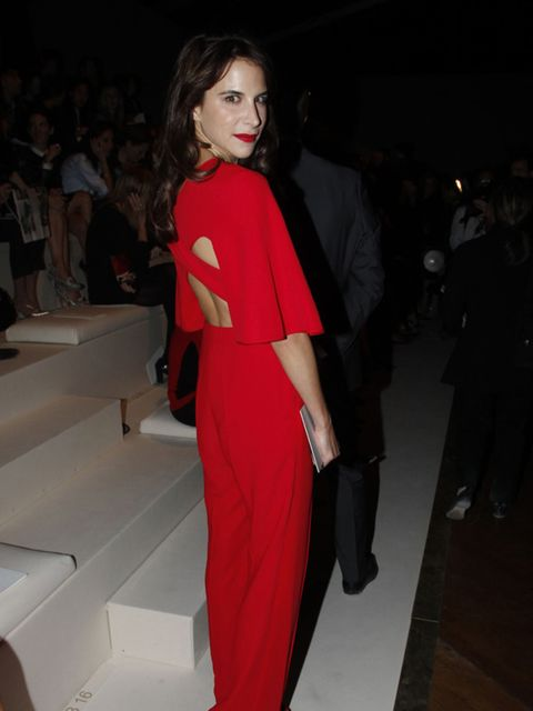<p>Caroline Sieber is wearing an open back catsuit to the Valentino Spring/Summer 2012 show during Paris Fashion Week, October 2011.</p>