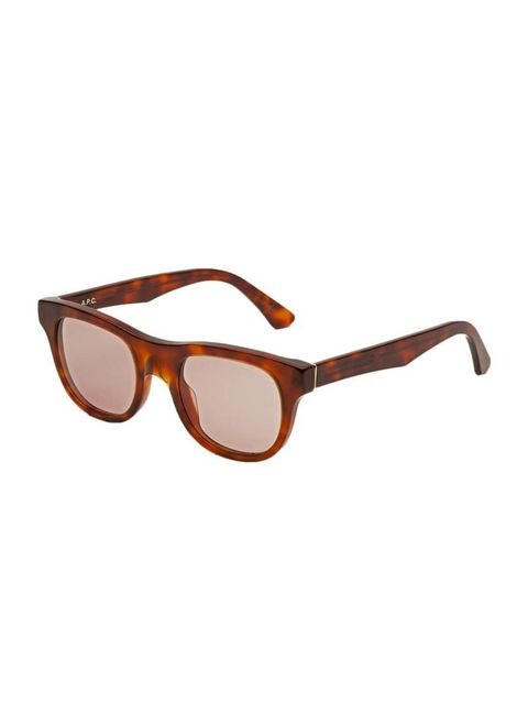"""<p>This collaboration makes for androgynous, understated sunnies that you'll be wearing for years to come.</p><p><a href=""""http://retrosuperfuture.com/apc/collections/apc-ss2015/00v"""" target=""""_blank"""">RetroSuperFuture x A.P.C.</a> sunglasses, £142</p>"""