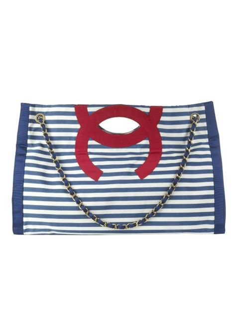 <p>Nautical tote bag, £1,380, by Chanel (0207 493 5040)</p>