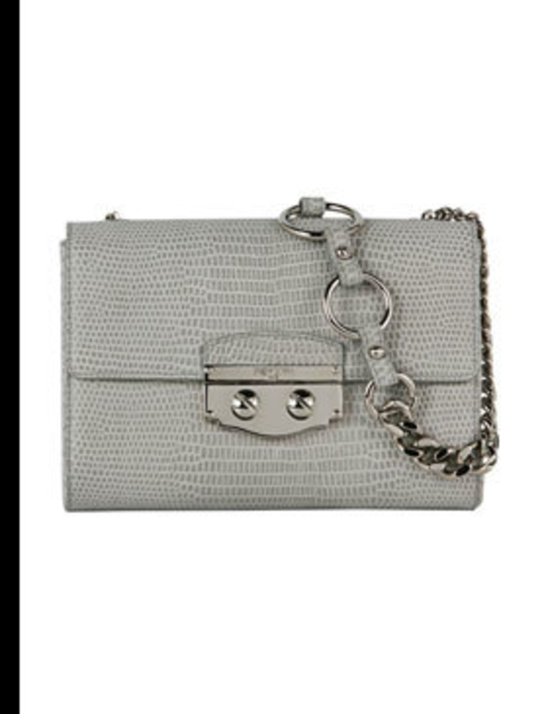 """<p> </p><p>'Le Sixieme' light grey suede lizard print bag, £980, by <a href=""""www.ysl.com"""">Yves Saint Laurent</a> </p>"""