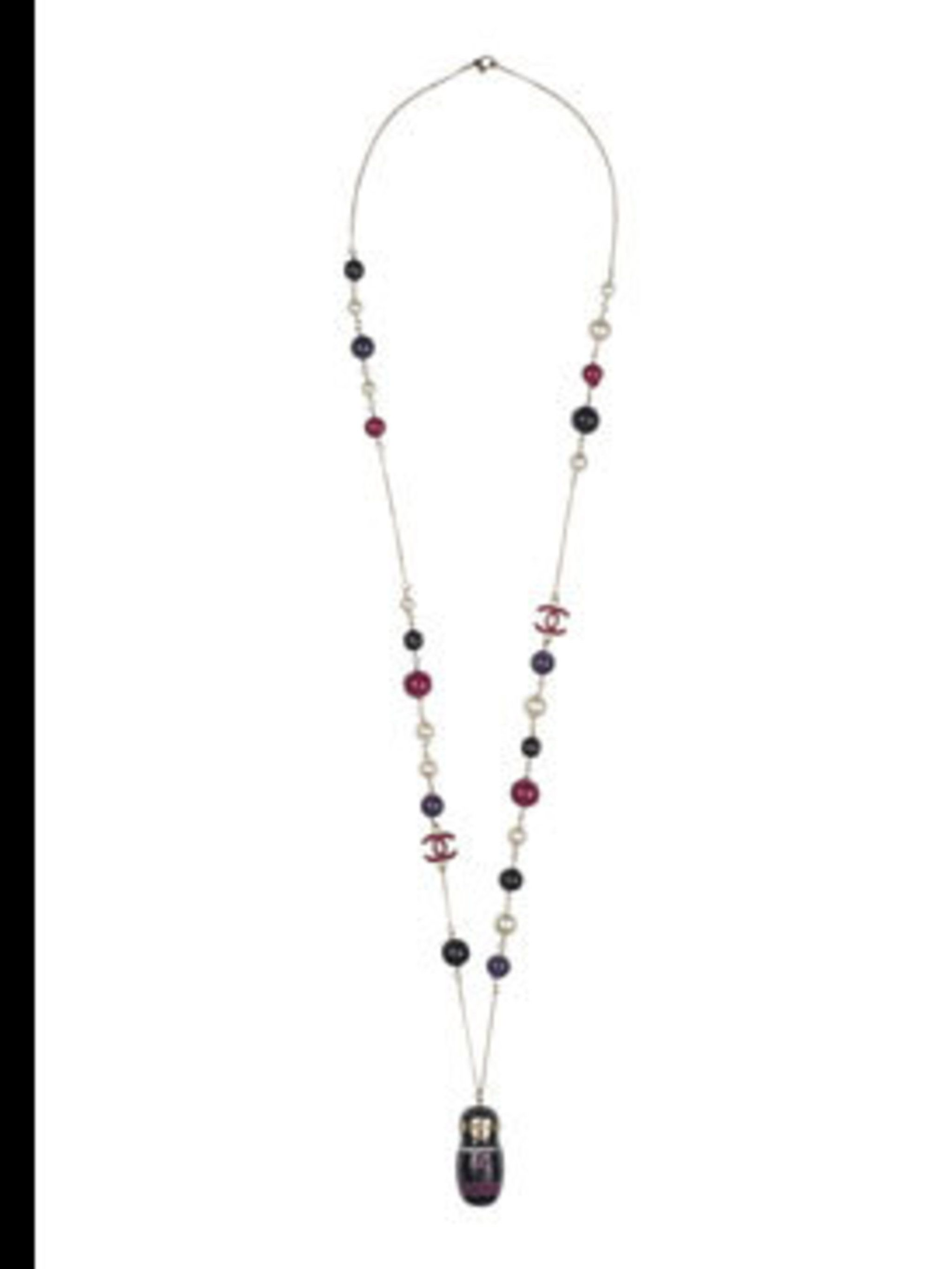 <p>Russian doll necklace, £850, by Chanel (020 7493 5040) </p>