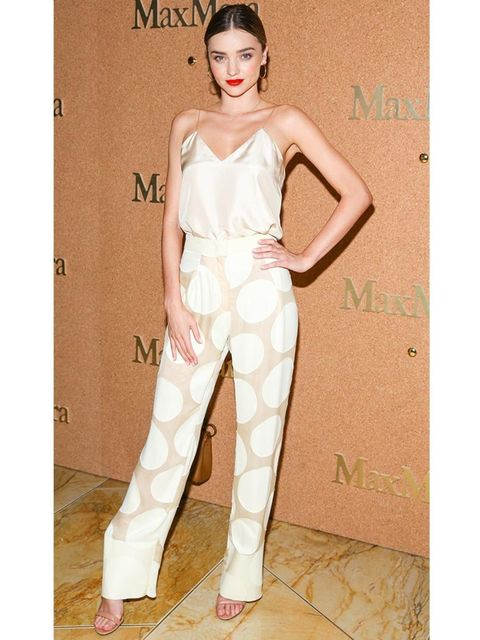 """<p>Miranda Kerr wears a Sportmax s/s 2014 ensemble to an event celebrating <a href=""""http://www.elleuk.com/fashion/trends/autumn-winter-2014-designer-advertising-campaign-images-prada-versace"""">Amy Adams as the new face of the Max Mara a/w 2014 accessories"""