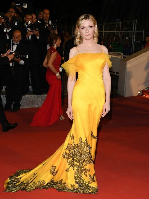 <p>Kirsten Dunst wears Maison Margiela Haute Couture designed by John Galliano to the 'Neon Demon' premiere during the 69th annual Cannes Film Festival</p>