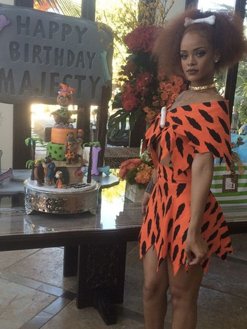 Rihanna takes on Pebbles for a Flintstones' themed birthday party for baby Majesty, June 2015.
