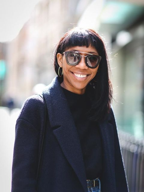 <p>Kenya Hunt, Style Features Director</p>  <p>Cos coat, Laura Valentini jumper, Junya Watanabe skirt, Mansur Gavriel bag, Prada glasses</p>