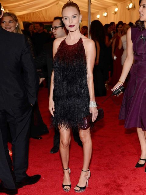 <p>Kate Bosworth in Prada. 'The dress was quite understated for something covered in feathers,' Beauty Writer Amy Lawrenson says, 'and I like that she tried something a bit different with the sleek bun and vampy lip.'</p>