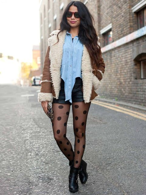 <p>Pattra, 24, student. Boots from Sweden, tights and shorts H&M, shirt and Jacket vintage, Mango clutch, glasses from Brick Lane.</p><p>Photo by Kirstin Sinclair</p>