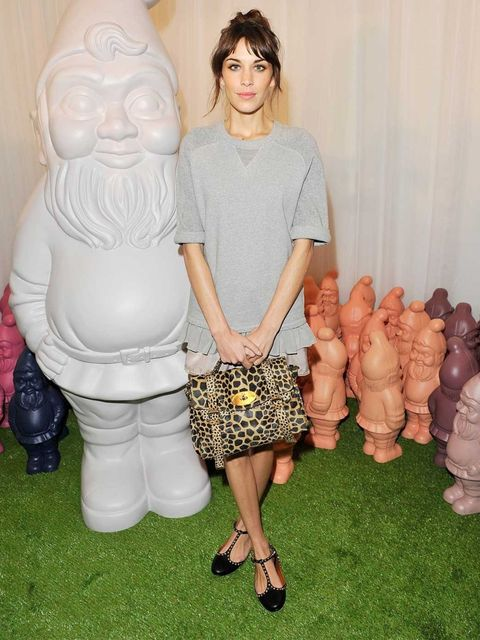 <p>Alexa Chung wore a Mulberry velvet tee and lace trim shorts, with a pair of Eliza T-Bar Ballerinas to the Mulberry SS13 show.</p>