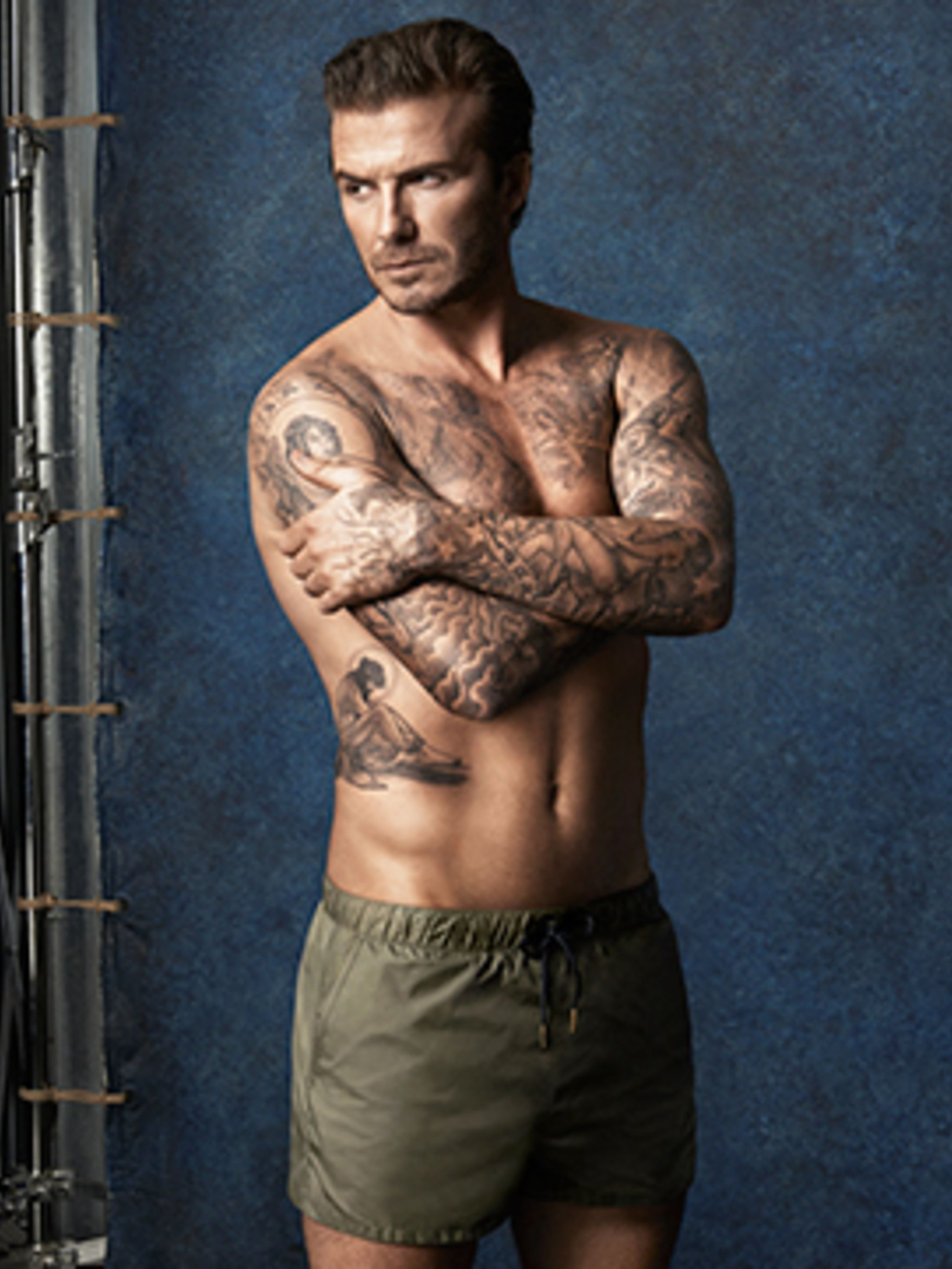<p>David Beckham models his debut swimwear line for H&M</p>