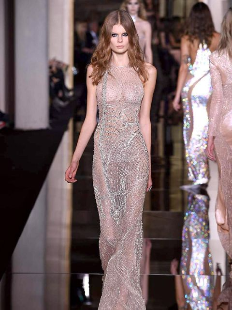 """<p><a href=""""http://www.elleuk.com/catwalk/versace/couture-ss-2015"""">Versace</a></p>"""