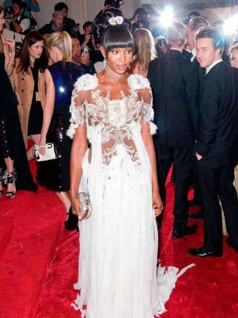 "<p>Naomi Campbell wearing a couture <a href=""http://www.elleuk.com/catwalk/collections/alexander-mcqueen/autumn-winter-2011/review"">Alexander McQueen</a> crystal embroidered tulle dress at The Met Ball, 2 May 2011 in New York.</p>"