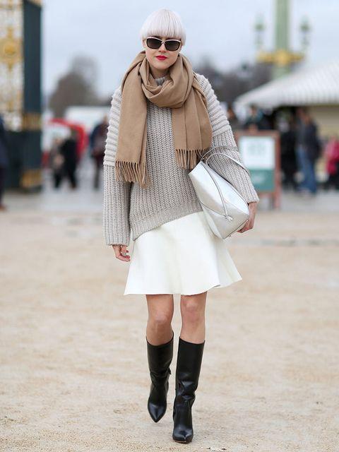 <p>Linda Tol wears Acne scarf, Balenciaga jumper, Zara skirt, LK Bennett bag, Oscar Tiye boots </p>