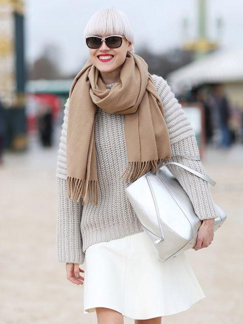 <p>Linda Tol wears Acne scarf, Balenciaga jumper, Zara skirt, LK Bennett bag</p>
