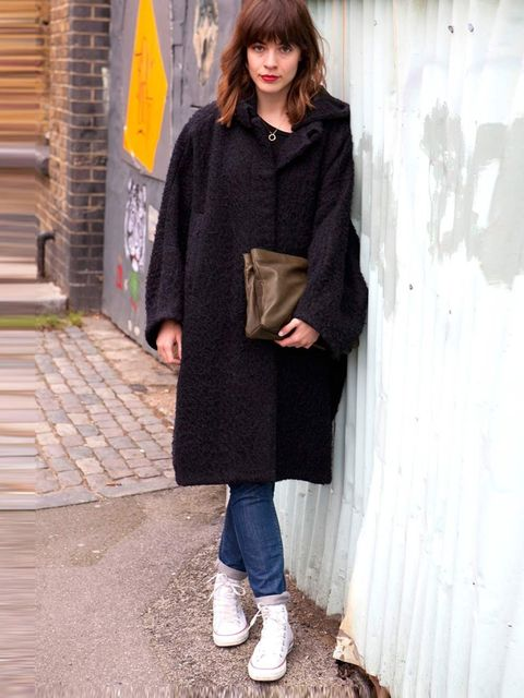 <p>Kate, 27, Assistant Buyer.Acne coat, Cos jeans and bag, Converse trainers.</p>
