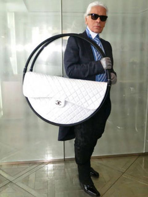 <p>Karl Lagerfeld with his Chanel hula hoop bag Spring Summer 2013</p>