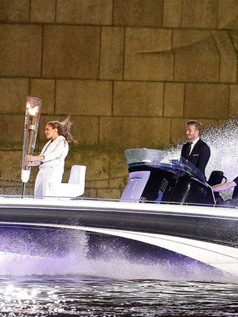 <p>David Beckham is the captain of the ship as he drives a speedboat with the Olympic flame down the river Thames as part of the 2012 Olympic Opening Ceremony Celebrations.</p>