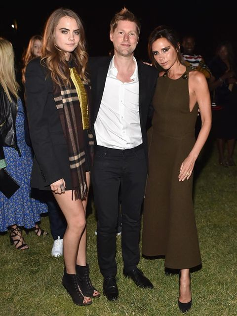 <p>Cara Delevingne, Christopher Bailery and Victoria Beckham at Burberry's 'London in Los Angeles' event, April 2015</p>
