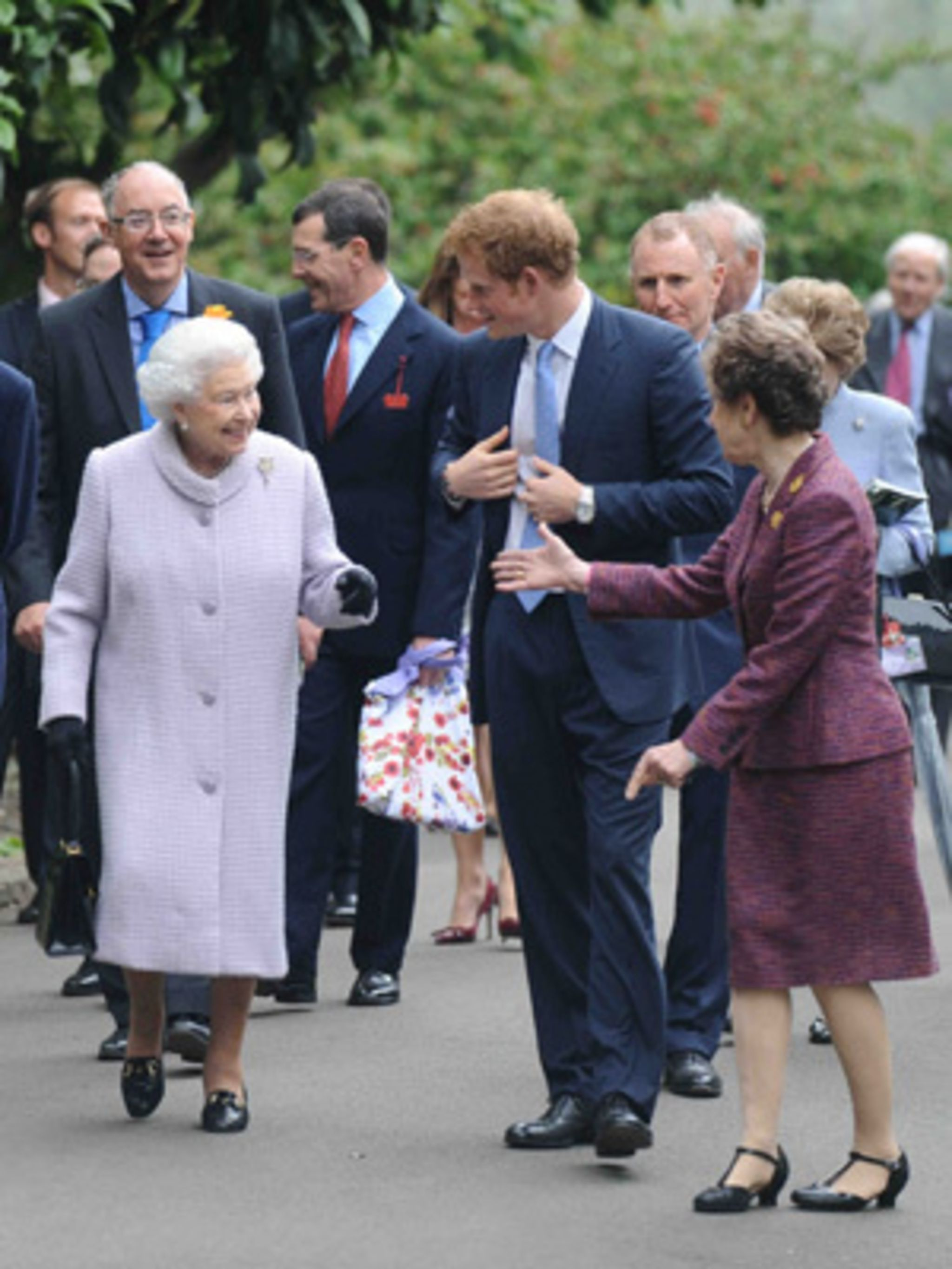 <p>The Queen and Prince Harry arrive at the 100th Chelsea Flower Show</p>