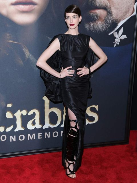 "<p><a href=""http://www.elleuk.com/star-style/celebrity-style-files/anne-hathaway"">Anne Hathaway</a> wears a black Tom Ford Spring 2013 dress and bondage boots to the New York premiere of Les Miserables.</p>"