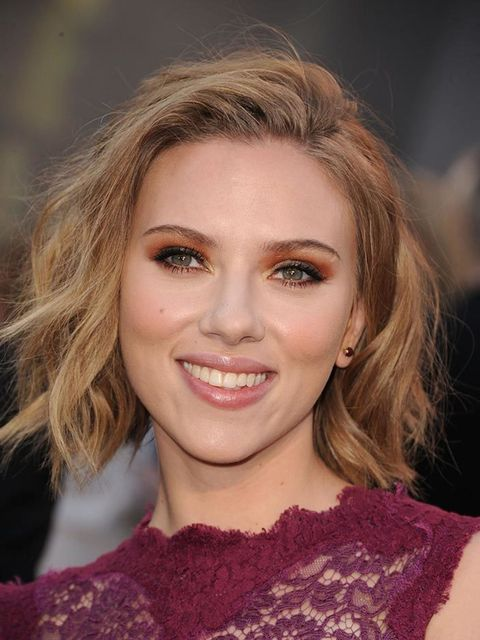 Scarlett adds volume and movement to her long bob for added texture.