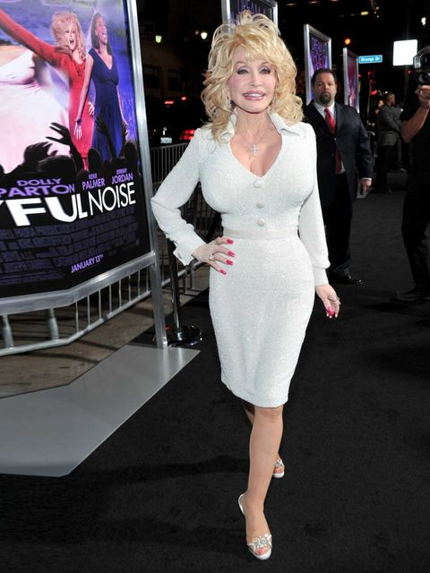 <p>Words fail us. From her epically-coiffed blond curls to her teeteringly high heels, country legend Dolly Parton is homedown glamour personified. AND WE LOVE HER FOR IT.</p>