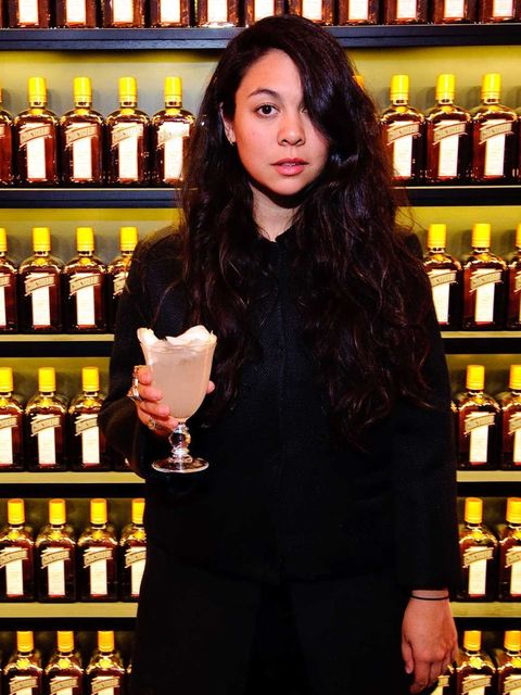 <p>Simone poses with her specially created cocktail: Cointreau Fizz Wild Rose.</p>