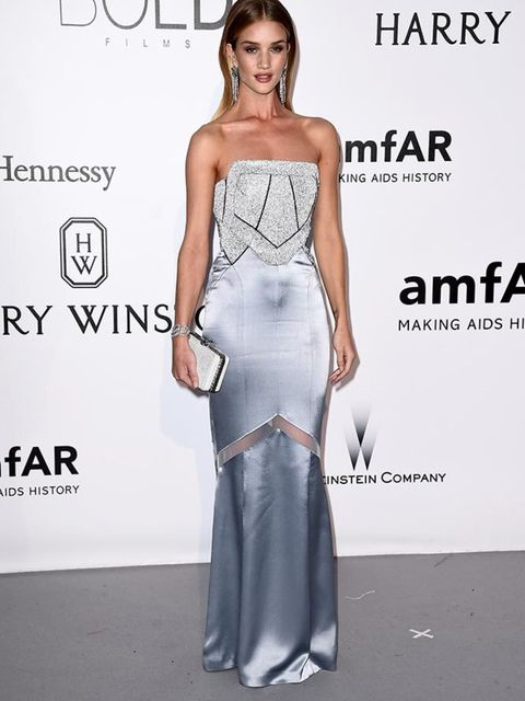 <p>Rosie Huntington-Whiteley wearing a bespoke Galvin for Opening Ceremony gown featuring statement Swarovski crystal fabric. on the amfAR red carpet, May 2016.</p>