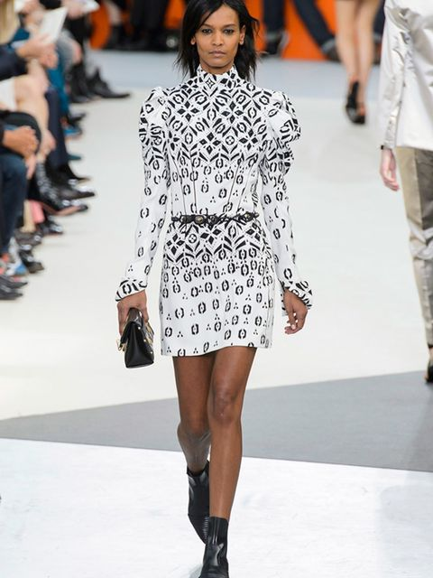 <p>LOUIS VUITTON</p>  <p>Everything about this look says Nicholas Ghesquière's Louis Vuitton, and his obsession with retro-futurism. Take a 1890s sleeve, give it a 1980s dress shape, throw an abstract LV monogram print on it, wear it with a flat, black po